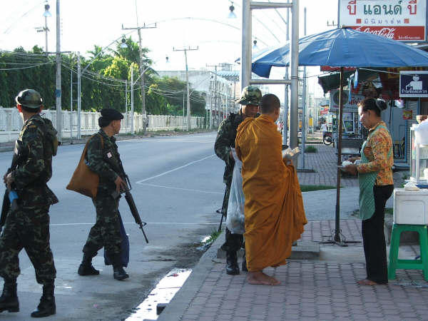 The Thai military inspecting a Buddhist monk, somewhere in the Muslim-majority area of southern Thailand.